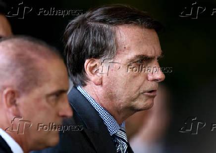 O futuro chefe da Casa Civil, Onyx Lorenzoni, com Bolsonaro