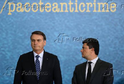 Jair Bolsonaro com o ministro da Justiça, Sergio Moro, em cerimônia em Brasília