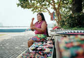 Indigenous woman weaving at stall, Ciudad de Panamá, Panama