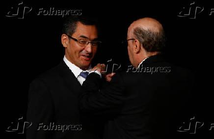 O ministro da Fazenda, Eduardo Guardia e seu antecessor Henrique Meirelles